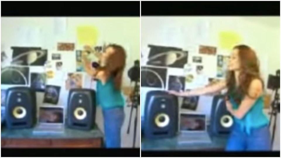 <p>I know this photo is wildly blurry, but I simply had to include how excited Emmy Rossum was to show off these extremely mediocre speakers.</p>