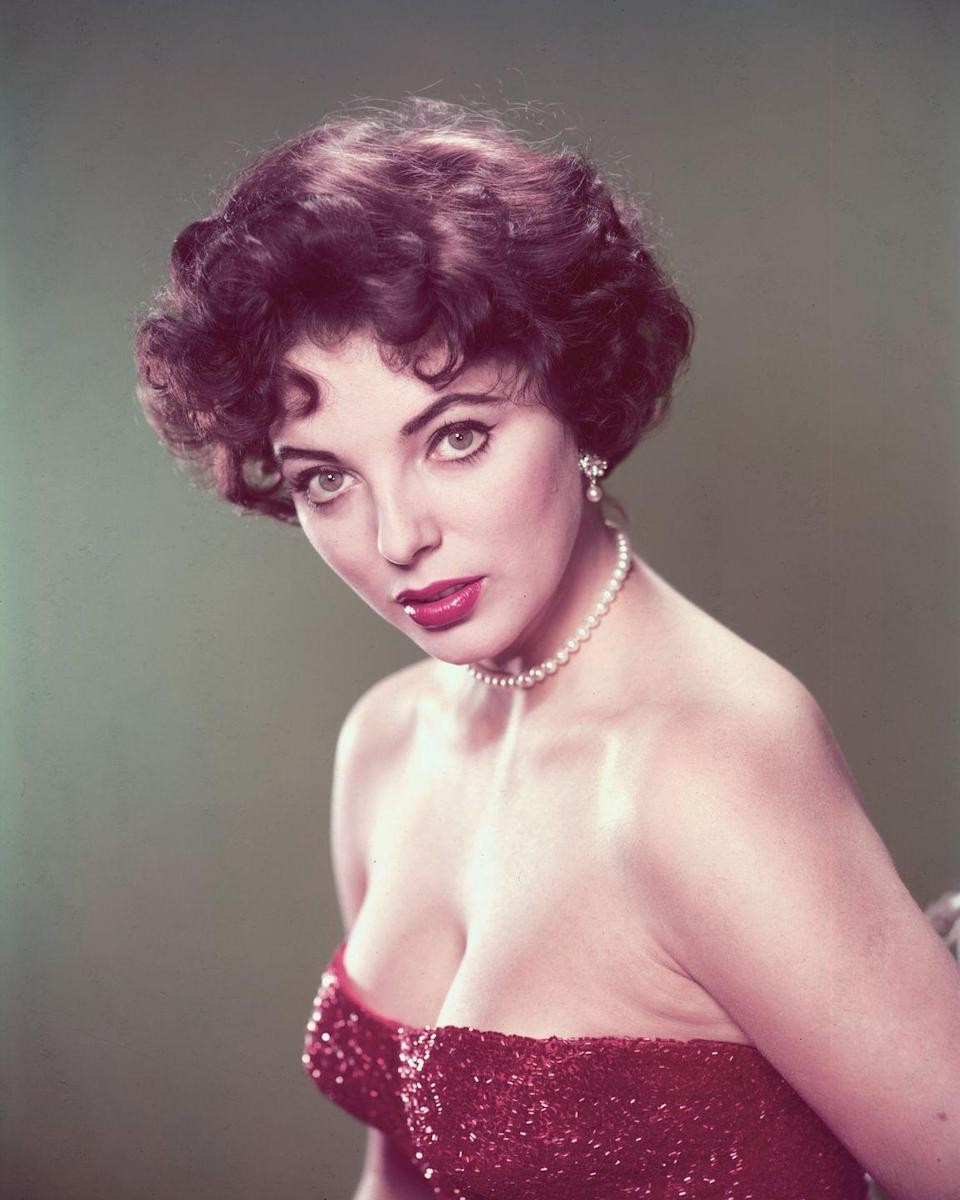 """<p>Two years after being hailed """"the most beautiful girl in the world"""", Collins kept things simple for this photo-shoot by pairing her strapless dress with a string of white pearls and matching earrings. </p>"""