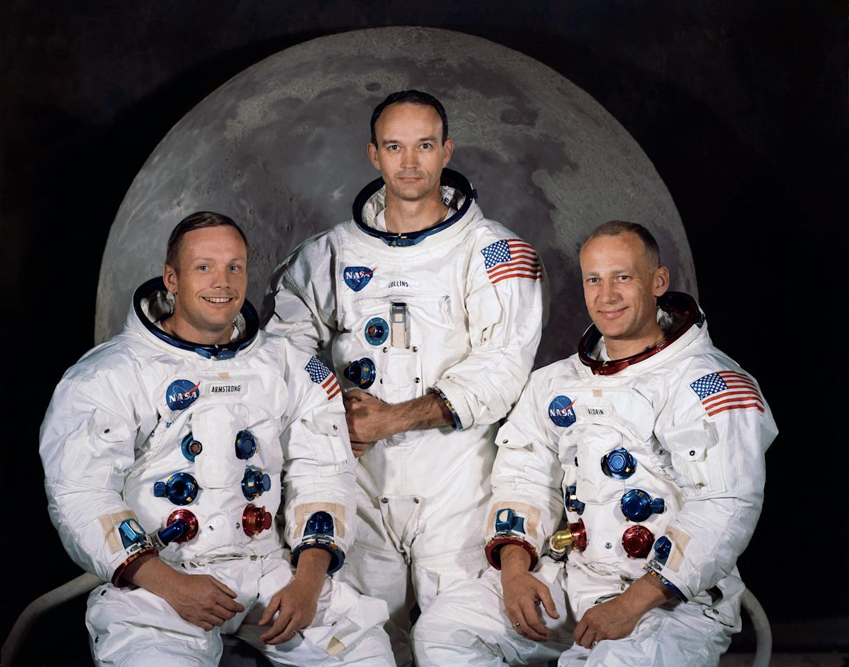 """FILE - In this 1969 photo provided by NASA the crew of the Apollo 11 mission is seen. From left are Neil Armstrong, Mission Commander, Michael Collins, Lt. Col. USAF, and Edwin Eugene Aldrin, also known as Buzz Aldrin, USAF Lunar Module pilot. The family of Neil Armstrong, the first man to walk on the moon, says he has died at age 82. A statement from the family says he died following complications resulting from cardiovascular procedures. It doesn't say where he died. Armstrong commanded the Apollo 11 spacecraft that landed on the moon July 20, 1969. He radioed back to Earth the historic news of """"one giant leap for mankind."""" Armstrong and fellow astronaut Edwin """"Buzz"""" Aldrin spent nearly three hours walking on the moon, collecting samples, conducting experiments and taking photographs. In all, 12 Americans walked on the moon from 1969 to 1972. (AP Photo/NASA)"""