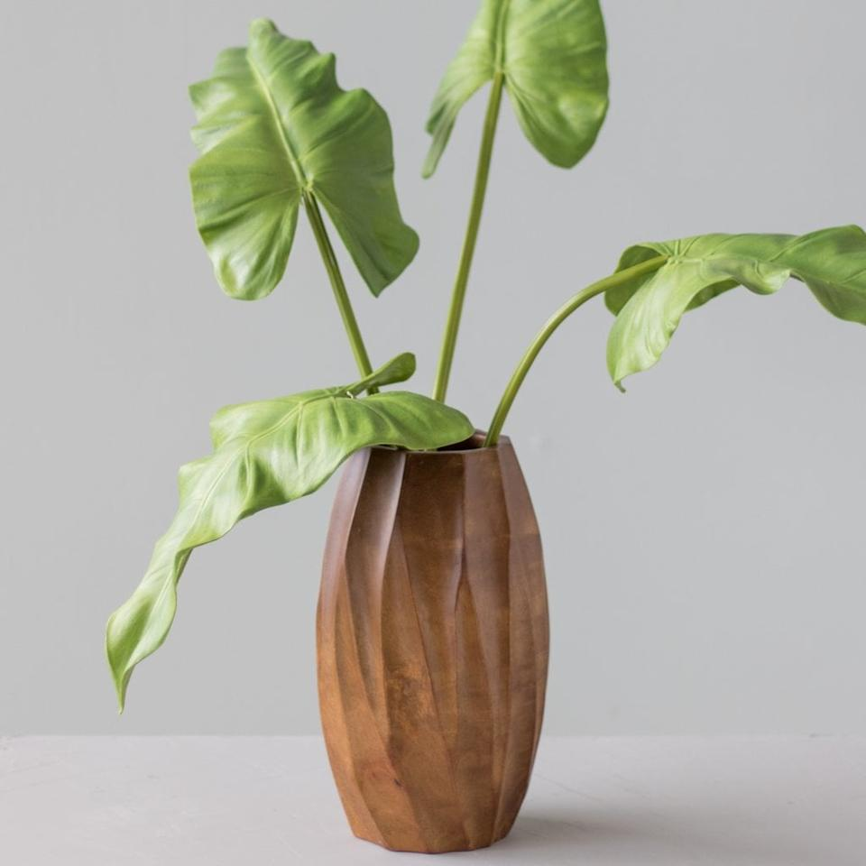 """<p>Forget the greens; the <a href=""""https://www.popsugar.com/buy/Carina-Mango-Wood-Vase-488108?p_name=Carina%20Mango%20Wood%20Vase&retailer=shop.magnolia.com&pid=488108&price=46&evar1=casa%3Aus&evar9=46582456&evar98=https%3A%2F%2Fwww.popsugar.com%2Fhome%2Fphoto-gallery%2F46582456%2Fimage%2F46582538%2FCarina-Mango-Wood-Vase&list1=shopping%2Cdecor%20shopping%2C50%20under%20%2450%2Cjoanna%20gaines%2Chome%20shopping%2Cmagnolia%20home&prop13=api&pdata=1"""" rel=""""nofollow"""" data-shoppable-link=""""1"""" target=""""_blank"""" class=""""ga-track"""" data-ga-category=""""Related"""" data-ga-label=""""https://shop.magnolia.com/collections/vases/products/carved-mango-vase"""" data-ga-action=""""In-Line Links"""">Carina Mango Wood Vase</a> ($46) looks beautiful displayed all by itself. </p>"""