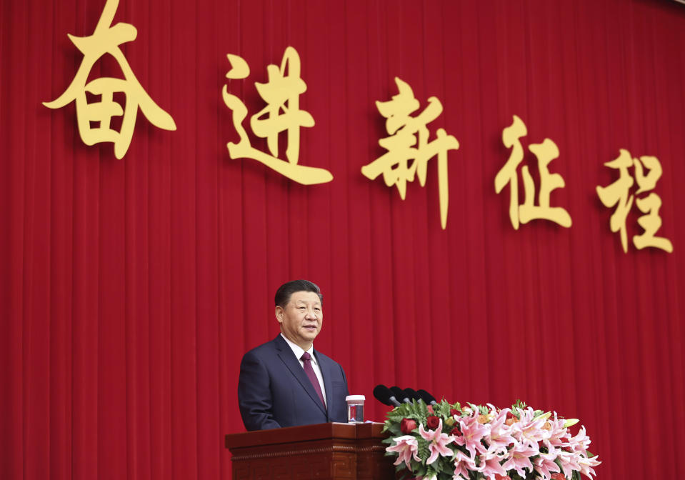 In this photo released by China's Xinhua News Agency, Chinese President Xi Jinping speaks at a New Year gathering hosted by the Chinese People's Political Consultative Conference (CPPCC) in Beijing, Thursday, Dec. 31, 2020. President Xi Jinping said in a New Year address that China has made major progress in developing its economy and eradicating rural poverty over the past year despite the coronavirus pandemic. (Ju Peng/Xinhua via AP)