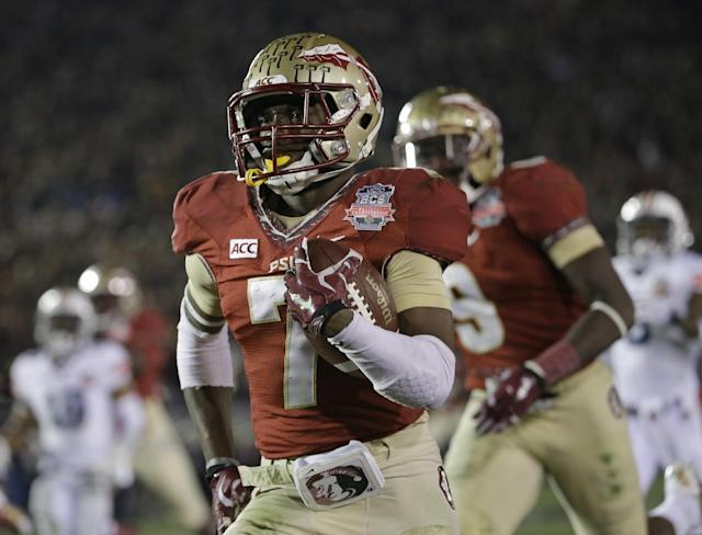 Florida State's Levonte Whitfield (7) runs back a kickoff for a touchdown during the second half of the NCAA BCS National Championship college football game against Auburn Monday, Jan. 6, 2014, in Pasadena, Calif. (AP Photo/David J. Phillip)