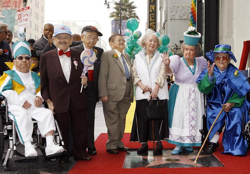 "FILE - In this Nov. 20, 2007, file photo, The Munchkins from ""The Wizard of Oz"" pose as they honored with a star on the Hollywood Walk of Fame at Grauman's Chinese Theatre, site of the film's 1939 premiere, in Los Angeles. The Munchkins cast members, from left: Clarence Swensen, a Munchkin soldier, Jerry Maren, part of the Lollipop Guild; Mickey Carroll, the Town Crier; Karl Slover, the Main Trumpeter; Ruth Duccini, a Munchkin villager; Margaret Pelligrini, the ""sleepyhead"" Munchkin and Meinhardt Raabe, the coroner. Ruth Robinson Duccini, 95, one of the two surviving Munchkins from the legendary film, died early Thursday, Jan. 16, 2014, in Las Vegas. (AP Photo/Damian Dovarganes, File)"