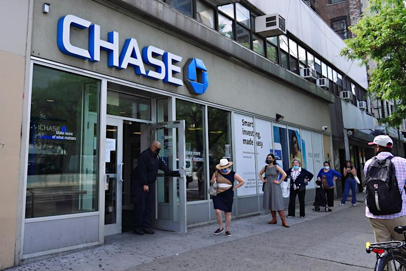 NEW YORK, NEW YORK - MAY 29: People wait in line outside CHASE bank to use the ATM machine during the coronavirus pandemic on May 29, 2020 in New York City. Government guidelines encourage wearing a mask in public with strong social distancing in effect as all 50 states in the USA have begun a gradual process to slowly reopen after weeks of stay-at-home measures to slow the spread of COVID-19. (Photo by Cindy Ord/Getty Images)
