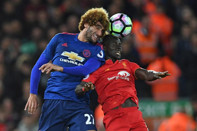 Manchester United's Marouane Fellaini (left) battles with Liverpool's Sadio Mane at Anfield on October 17, 2016