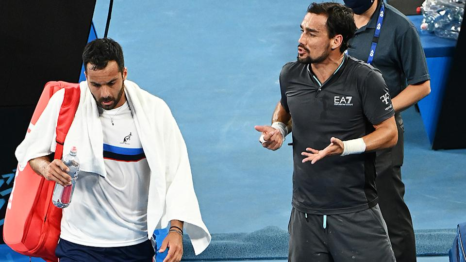 Fabio Fognini and Salvatore Caruso, pictured here exchanging words.