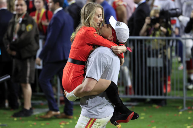 MIAMI, FLORIDA - FEBRUARY 02: Patrick Mahomes #15 of the Kansas City Chiefs celebrates with his girlfriend, Brittany Matthews, after defeating the San Francisco 49ers 31-20 in Super Bowl LIV at Hard Rock Stadium on February 02, 2020 in Miami, Florida. (Photo by Andy Lyons/Getty Images)