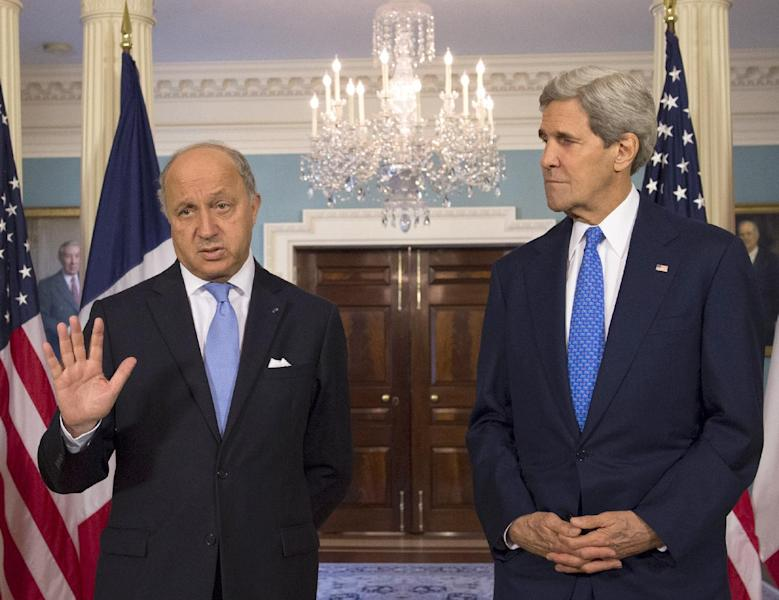 Secretary of State John Kerry listens as French Foreign Minister Laurent Fabius speaks prior to their meeting at the State Department in Washington, Tuesday, May 13, 2014. (AP Photo/Molly Riley)