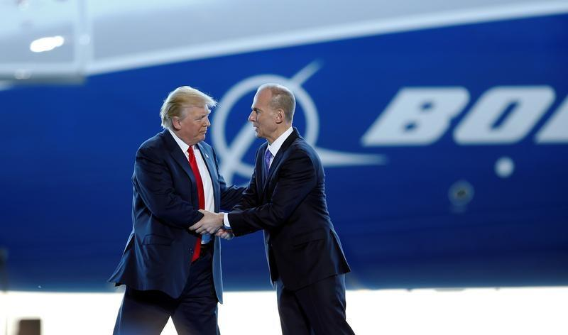 President Donald Trump greets Boeing Chairman, President and CEO Muilenburg during a ceremony celebrating the rollout of the Boeing 787-10 Dreamliner in North Charleston