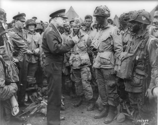 <p>Allied forces Supreme Allied Commander Gen. Dwight D. Eisenhower speaks with U.S. Army paratroopers of Easy Company, 502nd Parachute Infantry Regiment (Strike) of the 101st Airborne Division at the RAF Greenham Common airfield in England on June 5, 1944. (Photo: U.S. National Archives/handout via Reuters) </p>