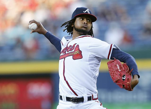 Atlanta Braves starting pitcher Ervin Santana works in the first inning of a baseball game against the Cincinnati Reds Friday, April , 25, 2014 in Atlanta. (AP Photo/John Bazemore)