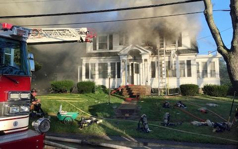 Firefighters battle another house on fire, on Herrick Road in North Andover - Credit: Mary Schwalm