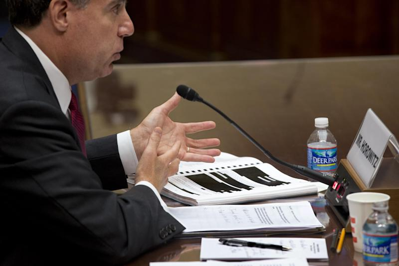 "Michael Horowitz, the Justice Department's inspector general, testifies before the House Oversight and Government Reform Committee a day after he faulted the department for disregard of public safety in ""Operation Fast and Furious,"" the Bureau of Alcohol, Tobacco, Firearms and Explosives' program that allowed hundreds of guns to reach Mexican drug gangs, on Capitol Hill in Washington, Thursday, Sept. 20, 2012. Parts of his 470-page report, seen on the witness table, were redacted for public release. (AP Photo/J. Scott Applewhite)"