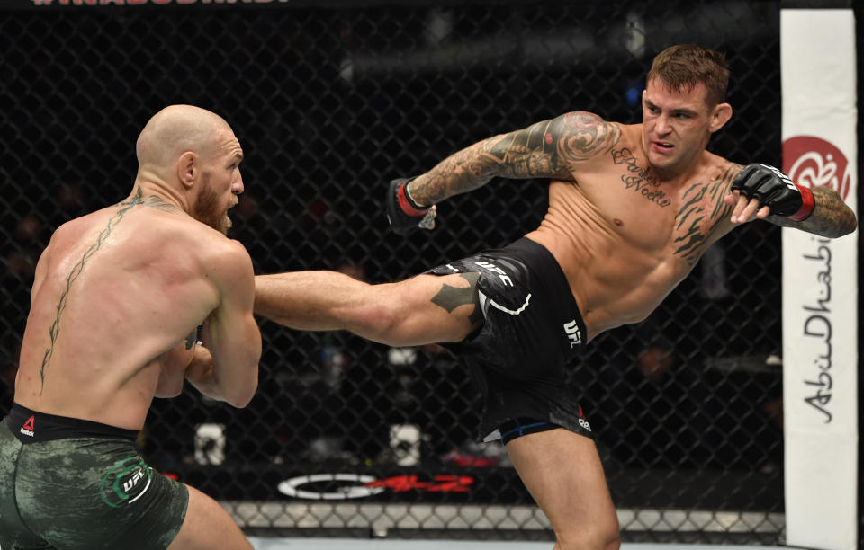 Dustin Poirier kicks Conor McGregor of Ireland in a lightweight fight during the UFC 257 event in January 2021
