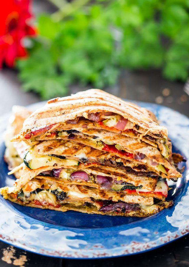 """<p>Who says veggies aren't fun? These loaded quesadillas are a fun new way to serve grilled vegetables.</p><p><strong>Get the recipe at <a href=""""https://www.jocooks.com/type/healthy-eating/grilled-vegetable-quesadillas/"""" rel=""""nofollow noopener"""" target=""""_blank"""" data-ylk=""""slk:Jo Cooks"""" class=""""link rapid-noclick-resp"""">Jo Cooks</a>.</strong></p><p><a class=""""link rapid-noclick-resp"""" href=""""https://go.redirectingat.com?id=74968X1596630&url=https%3A%2F%2Fwww.walmart.com%2Fip%2FThe-Pioneer-Woman-Timeless-Beauty-Pre-Seasoned-Plus-20-Cast-Iron-Double-Griddle%2F117723541&sref=https%3A%2F%2Fwww.thepioneerwoman.com%2Ffood-cooking%2Fmeals-menus%2Fg32188535%2Fbest-grilling-recipes%2F"""" rel=""""nofollow noopener"""" target=""""_blank"""" data-ylk=""""slk:SHOP GRIDDLES"""">SHOP GRIDDLES </a></p>"""