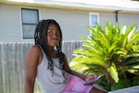 Lyric Green, 7, poses for a photo in Thibodaux, Louisiana, following the passage of Hurricane Ida. Green was born with asthma, which is aggravated by the annual burning of sugarcane fields around her neighborhood. She uses two inhalers for her illness, and her mom worries about her health following the hurricane.