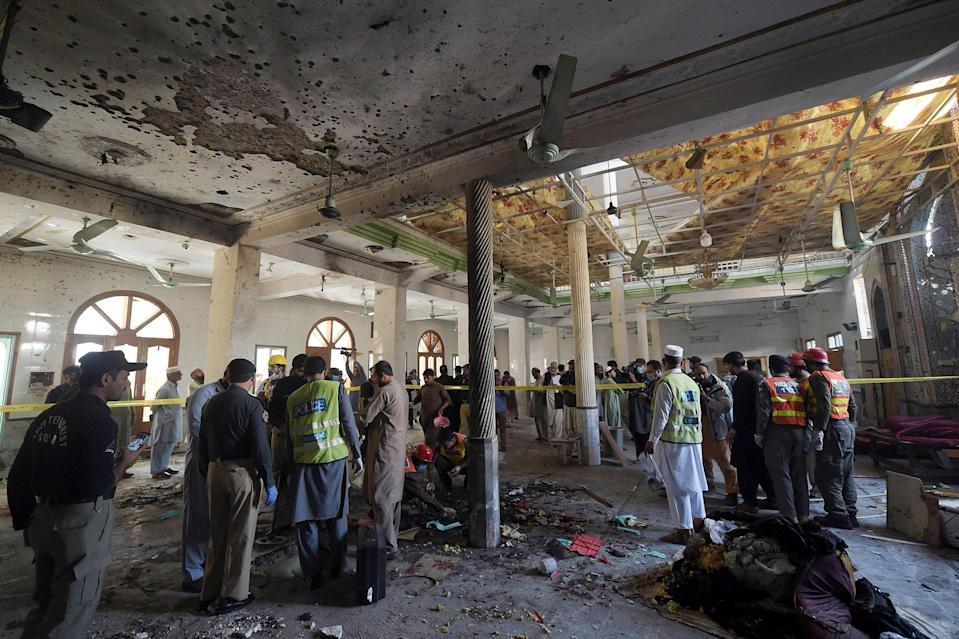 Security officials examine the site of the blast (AFP via Getty Images)