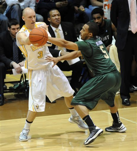 Valparaiso guard Will Bogan, left, throws a pass around Wright State guard Miles Dixon e during the first half of an NCAA college basketball game in the final of Horizon League Conference tournament Tuesday March 12, 2013 in Valparaiso, Ind. (AP Photo/Joe Raymond)