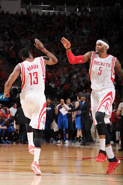 HOUSTON, TX - APRIL 21: James Harden #13 high fives Josh Smith #5 of the Houston Rockets after a play against the Dallas Mavericks during Game Two of the Western Conference Quarterfinals of the 2015 NBA Playoffs on April 21, 2015 at the Toyota Center in Houston, Texas. (Photo by Bill Baptist/NBAE via Getty Images)