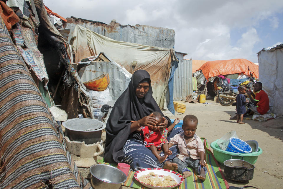 Fatuma Mohamed, whose husband died of COVID-19 and struggles to raise two young children while earning money by doing laundry when she can, sits by her makeshift home in Mogadishu, Somalia Sunday, July 25, 2021. Among the women Somali presidential hopeful Fawzia Yusuf H. Adam hopes to help if elected president are people like Fatuma. (AP Photo/Farah Abdi Warsameh)