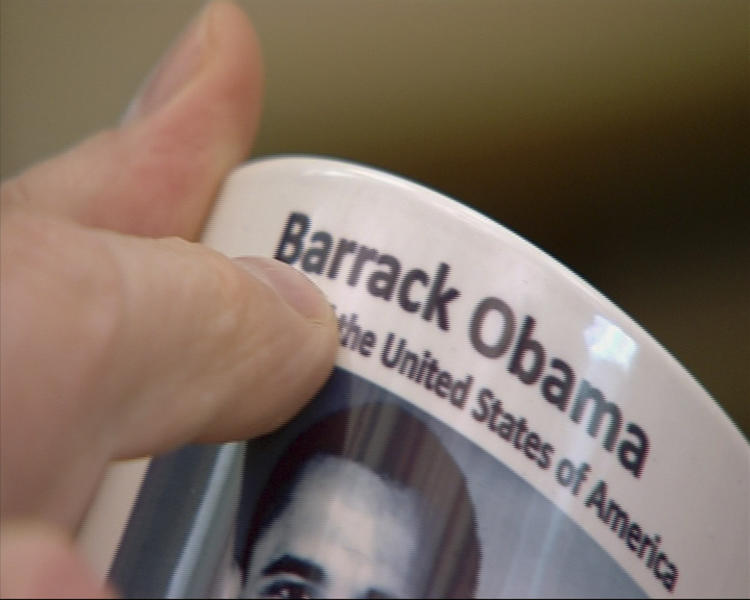 """In this June 7, 2010 image from television supplied by Network 10, a commemorative coffee mug from the 2010 presidential visit by Barack Obama showing the miss spelling of his first name is held at Parliament House in Canberra, Australia. A Parliament House official told senators on Monday, May 21, 2012 that 198 mugs were smashed and buried under wet concrete at a loading dock behind the building. One senator called it a """"mafia-style execution"""" for the mugs, which had an extra """"r"""" printed in Obama's first name. (AP Photo/Network 10) AUSTRALIA OUT"""