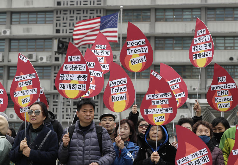 "Protesters hold signs during a rally demanding the denuclearization of the Korean Peninsula and peace treaty near the U.S. embassy in Seoul, South Korea, Thursday, March 21, 2019. The Korean Peninsula remains in a technical state of war because the 1950-53 Korean War ended with an armistice, not a peace treaty. More than 20 protesters participated at a rally and also demanding the end the Korean War and to stop the sanction on North Korea. The letters read ""Restarting operations at Kaesong industrial complex and Diamond Mountain resort."" (AP Photo/Lee Jin-man)"