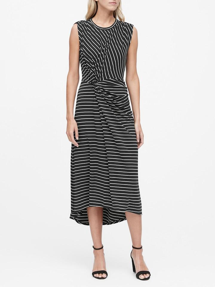"""<p>Throw on a little cardigan over this <a href=""""https://www.popsugar.com/buy/Stripe-Twist-Front-Midi-Dress-498992?p_name=Stripe%20Twist-Front%20Midi%20Dress&retailer=bananarepublic.gap.com&pid=498992&price=59&evar1=fab%3Aus&evar9=46726271&evar98=https%3A%2F%2Fwww.popsugar.com%2Ffashion%2Fphoto-gallery%2F46726271%2Fimage%2F46726667%2FStripe-Twist-Front-Midi-Dress&list1=shopping%2Cbanana%20republic%2Coffice%2Cworkwear&prop13=mobile&pdata=1"""" rel=""""nofollow"""" data-shoppable-link=""""1"""" target=""""_blank"""" class=""""ga-track"""" data-ga-category=""""Related"""" data-ga-label=""""https://bananarepublic.gap.com/browse/product.do?pid=493309002&amp;cid=1105432&amp;pcid=48422&amp;vid=1&amp;grid=pds_102_543_1#pdp-page-content"""" data-ga-action=""""In-Line Links"""">Stripe Twist-Front Midi Dress </a> ($59, originally $99).</p>"""
