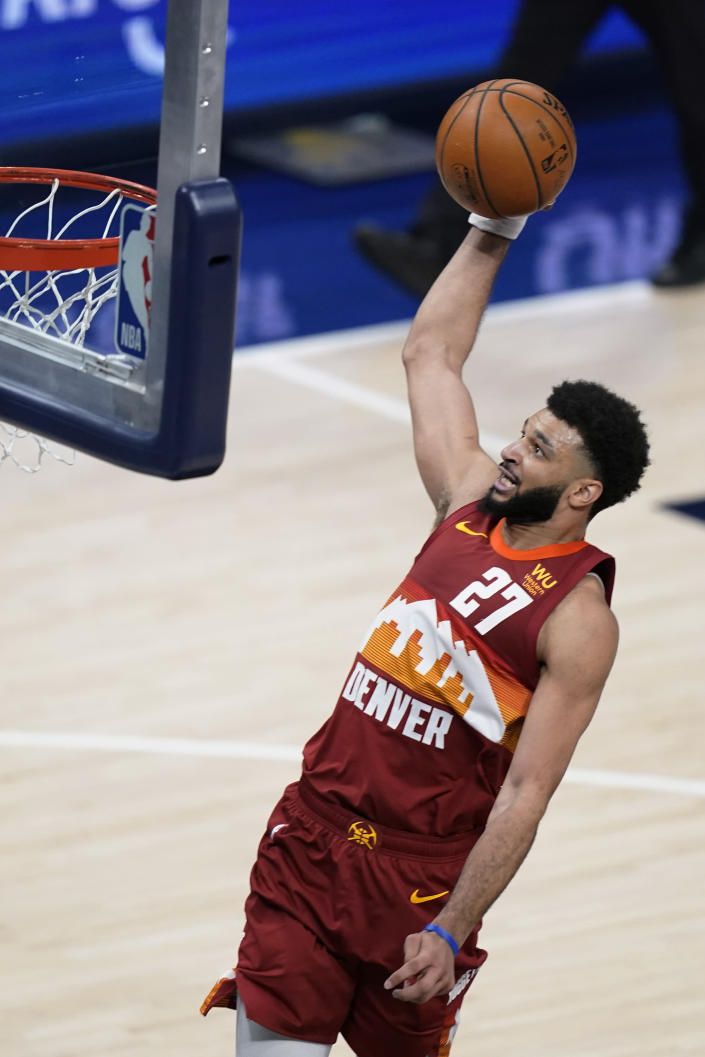 Denver Nuggets' Jamal Murray goes up for a dunk during the second half of the team's NBA basketball game against the Indiana Pacers, Thursday, March 4, 2021, in Indianapolis. (AP Photo/Darron Cummings)