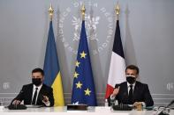 French President Emmanuel Macron and Ukrainian President Volodymyr Zelenskiy hold a news conference following their meeting at the Elysee Palace in Paris