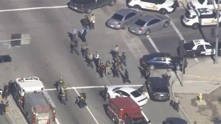 A still image from a video footage courtesy of Nbcla.com shows first responders responding to a shooting at the California Department of Developmental Services Inland Regional Center, one of 21 facilities serving people with developmental disabilities, in San Bernardino, California December 2, 2015. REUTERS/NBCLA.COM/Handout