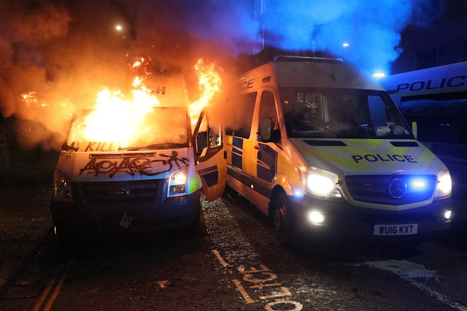 A vandalised police van on fire outside Bridewell Police Station, as other police vehicles arrive after protesters demonstrated against the Government's controversial Police and Crime Bill. Picture date: Sunday March 21, 2021. (Photo by Andrew Matthews/PA Images via Getty Images)