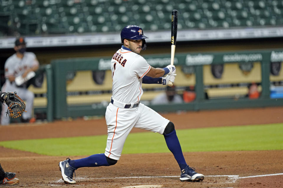 Houston Astros' Carlos Correa hits an RBI-single against the San Francisco Giants during the second inning of a baseball game Monday, Aug. 10, 2020, in Houston. (AP Photo/David J. Phillip)