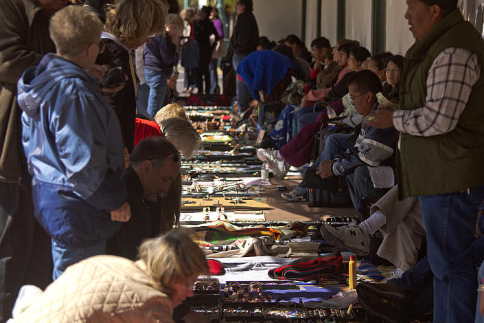 Native Americans selling arts and crafts in front of the Palace of the Governors in Santa Fe, N.M., on Oct. 13, 2012. (Photo: Raunger Ullstein Bild via Getty Images)