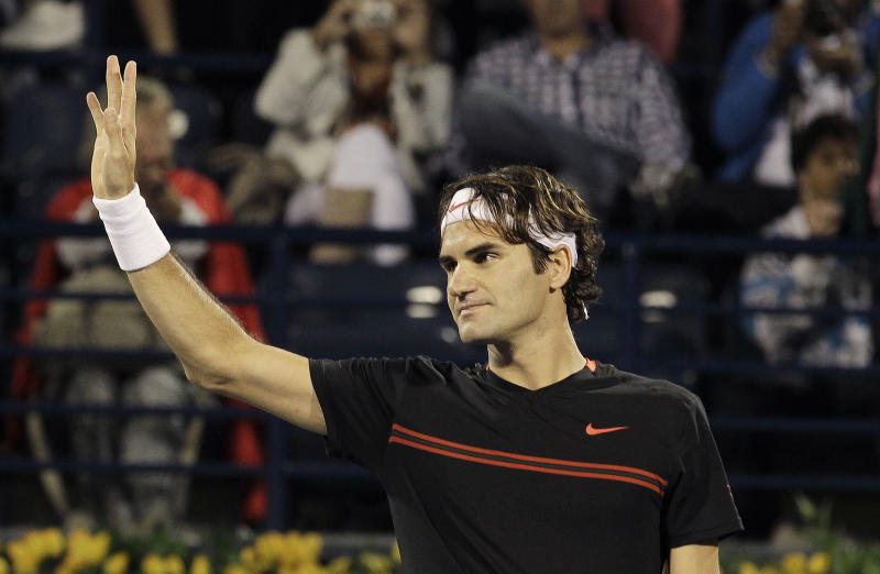Roger Federer of Switzerland celebrates defeating Micheal Llodra of France during the Emirates Dubai ATP Tennis Championships in Dubai, United Arab Emirates, Tuesday, Feb. 28, 2012. (AP Photo/Hassan Ammar)