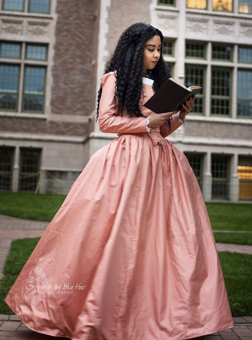 """<p>If you won't be """"Satisfied"""" unless your costume looks exactly like Angelica Schuyler's dress, take a page from <a href=""""https://www.ourshieldmaiden.com/"""" rel=""""nofollow noopener"""" target=""""_blank"""" data-ylk=""""slk:cosplayer Emilee Shield"""" class=""""link rapid-noclick-resp"""">cosplayer Emilee Shield</a>'s breathtaking photo shoot by <a href=""""https://ko-fi.com/girlwiththebluehair?fbclid=IwAR21iNyyHyKpSnh2DnQqvw4CNuKjS61fqlKwoA-tzM4bMg89y0q8aXU7SVU"""" rel=""""nofollow noopener"""" target=""""_blank"""" data-ylk=""""slk:Girl With the Blue Hair Photography"""" class=""""link rapid-noclick-resp"""">Girl With the Blue Hair Photography</a>. (Fair warning: This complete look took Shield more than 300 hours worth of sewing to complete! So maybe opt to buy your own?)</p><p><a class=""""link rapid-noclick-resp"""" href=""""https://www.amazon.com/Hamilton-Angelica-Dancewear-Sunflower-Necklace/dp/B083461ZJ6/ref=sr_1_1?crid=161DKEHWD29AN&dchild=1&keywords=angelica+dress+hamilton&qid=1598658482&sprefix=angelica+dress%2Caps%2C161&sr=8-1&tag=syn-yahoo-20&ascsubtag=%5Bartid%7C10055.g.33836165%5Bsrc%7Cyahoo-us"""" rel=""""nofollow noopener"""" target=""""_blank"""" data-ylk=""""slk:SHOP DRESS ON AMAZON"""">SHOP DRESS ON AMAZON</a></p>"""