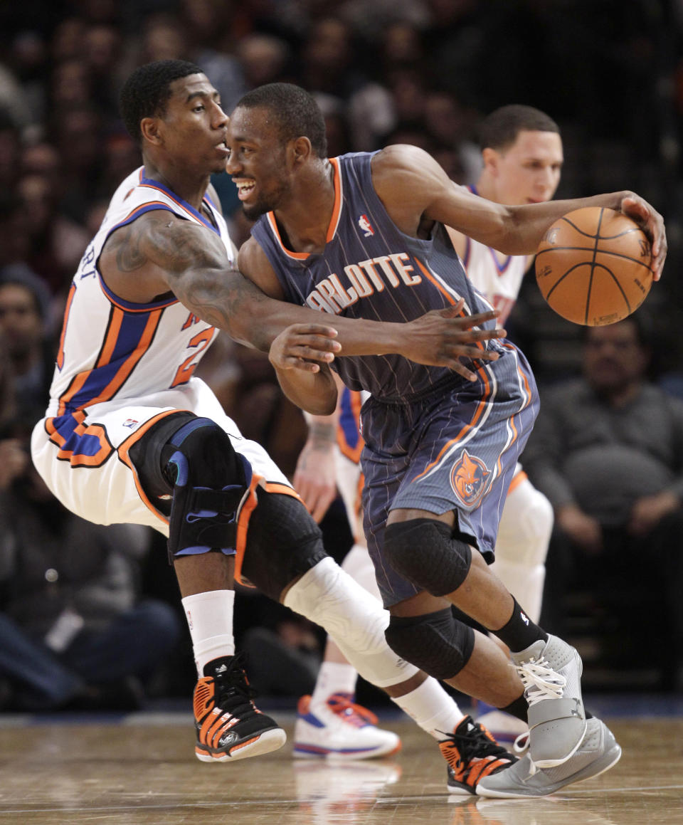FILE - New York Knicks guard Iman Shumpert (21) defends Charlotte Hornets' Kemba Walker in the fourth quarter of the Knicks' 91-87 victory in an NBA basketball game at Madison Square Garden in New York, in this Monday, Jan. 9, 2012, file photo. The New York Knicks have been looking long for a point guard and didn't have to search too far for their new one. Kemba Walker is from New York and is coming back to the Madison Square Garden court where he's had plenty of success already. (AP Photo/Kathy Willens, File)