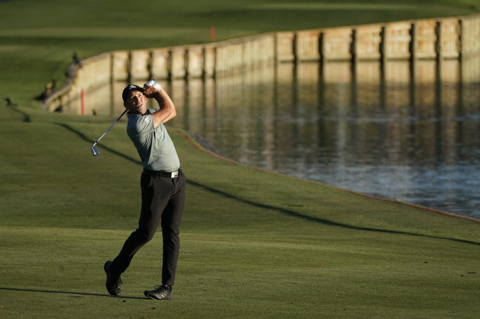 Sergio Garcia, of Spain, hits from the fairway on the 18th hole during the second round of the The Players Championship golf tournament Friday, March 12, 2021, in Ponte Vedra Beach, Fla. (AP Photo/Gerald Herbert)