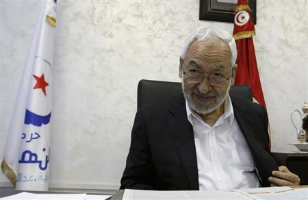 Rached Ghannouchi, leader of the Islamist Ennahda movement, speaks during an interview with a Reuters journalist in Tunis