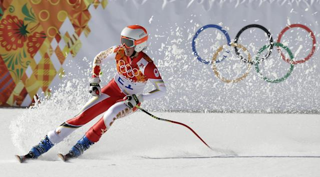 Canada's Marie-Michele Gagnon comes to a halt at the end of the downhill portion of the women's supercombined at the Sochi 2014 Winter Olympics, Monday, Feb. 10, 2014, in Krasnaya Polyana, Russia. (AP Photo/Gero Breloer)