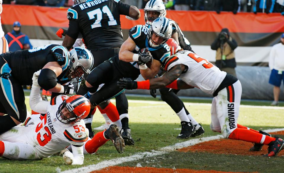Carolina Panthers running back Christian McCaffrey (22) scores a 1-yard touchdown during the first half of an NFL football game against the Cleveland Browns, Sunday, Dec. 9, 2018, in Cleveland. (AP Photo/Ron Schwane)