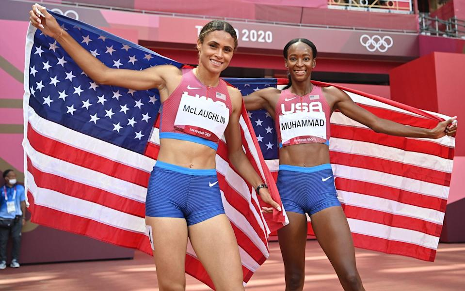 Sydney McLaughlin (left) and Dalilah Muhammad (right) hold up the Stars and Stripes - GETTY IMAGES