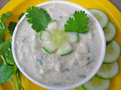 "<p>Cucumber is a cooling agent and is known for its numerous health benefits. Here's how to make a raita with cucumber. Add 1 diced or grated cucumber to a bowl of whisked yogurt. Add dry spice powders, salt or rock salt as required. Give it a good stir.Season it with chopped coriander or mint leaves. One can even add onions and tomatoes to this preparation. ""Creative Commons Cucumber Raita"" by Sonia Goyal is licensed under CC BY 2.0 </p>"