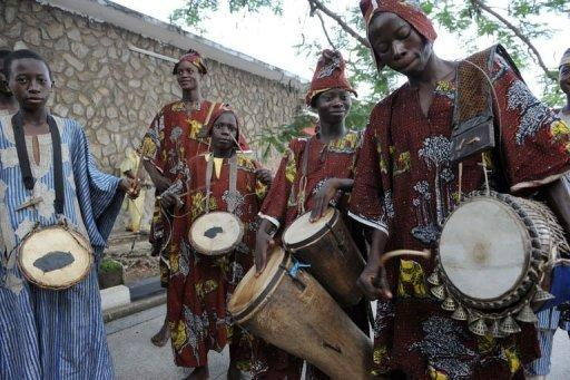 Talking drummers perform during a festival at the University of Ibadan, Oyo State, in June 2011. The West African talking drum, an hour-glass-shaped instrument usually made of wood and animal hide, is deeply embedded in the region's culture