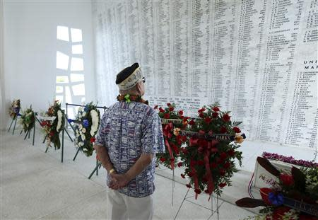 """USS Arizona survivor Louis Conter looks at names of sailors that died on the """"Remembrance Wall"""" during a wreath presentation ceremony on board the USS Arizona Memorial during the 72nd anniversary of the attack on Pearl Harbor at the WW II Valor in the Pacific National Monument in Honolulu, Hawaii on December 7, 2013. REUTERS/Hugh Gentry"""