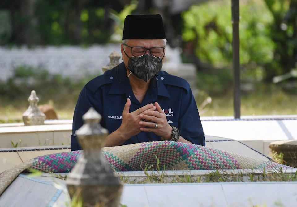 Prime Minister Datuk Seri Ismail Sabri Yaakob during a visit to his parents' graves in Temerloh, August 28, 2021. — Bernama pic