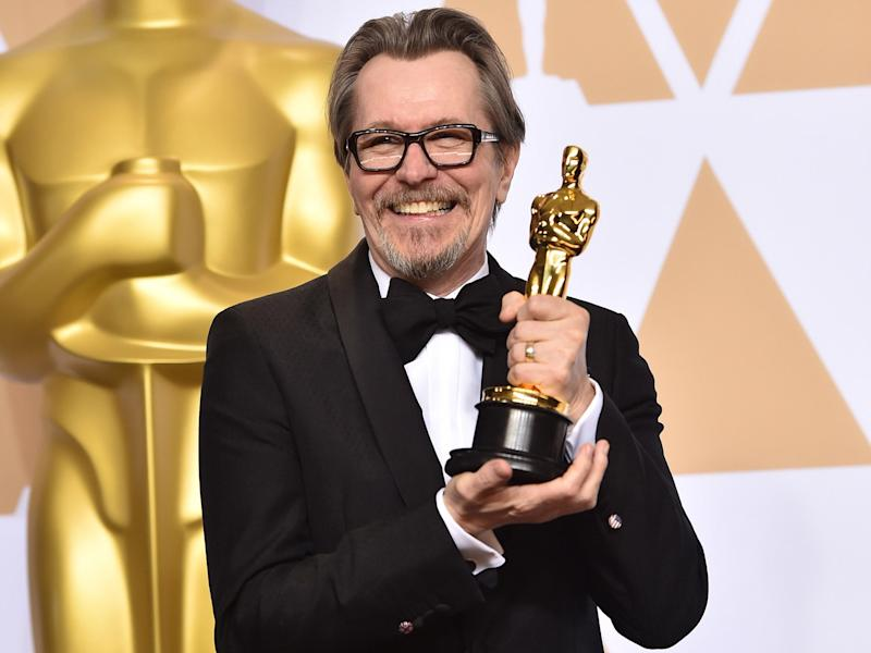 Gary Oldman, winner of the Best Actor award for 'Darkest Hour', poses with his accolade in the press room during the 90th Annual Academy Awards at the Hollywood and Highland CenterGetty