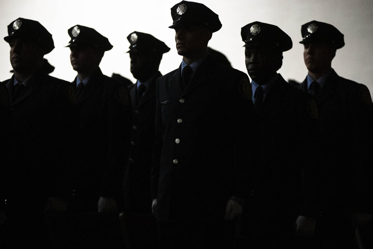 Philadelphia Fire Department cadets from Class 196 arrive for their graduation ceremony in Philadelphia, Wednesday, Nov. 13, 2019. These cadets will enable the department to start reopening companies that were closed during the Recession. (AP Photo/Matt Rourke)