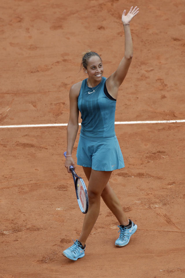 Madison Keys of the U.S. celebrates winning her third round match of the French Open tennis tournament against Japan's Naomi Osaka in two sets 6-1, 7-6 (9-7), at the Roland Garros stadium in Paris, France, Friday, June 1, 2018. (AP Photo/Alessandra Tarantino)