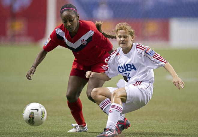 VANCOUVER, CANADA - JANUARY 21:  Yisel Rodriguez #16 of Cuba knocks the ball away from Robyn Gayle #5 of Canada during the first half of the 2012 CONCACAF Women's Olympic Qualifying Tournament at BC Place on January 21, 2012 in Vancouver, British Columbia, Canada.  (Photo by Rich Lam/Getty Images)