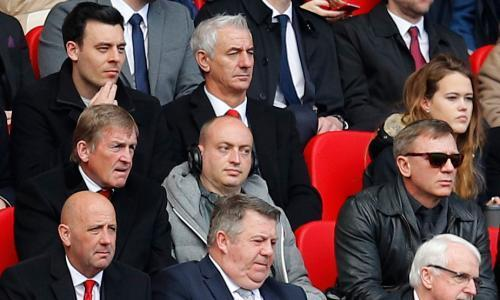 "<span class=""element-image__caption"">Kenny Dalglish watches from behind Gary McAllister, with Ian Rush in the row behind – and Daniel Craig wearing sunglasses.</span> <span class=""element-image__credit"">Photograph: Phil Noble/Reuters</span>"
